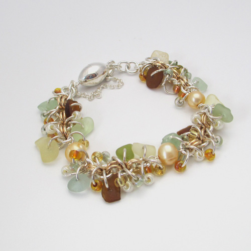 gold and silver chainmaille style sea glass bracelet